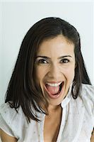 Woman, smiling at camera, mouth wide open, portrait Stock Photo - Premium Royalty-Freenull, Code: 695-05766183