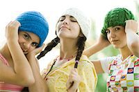 preteen girl pigtails - Young female friends wearing knit hats, looking at camera Stock Photo - Premium Royalty-Freenull, Code: 695-05766247