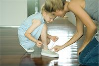 family shoes - Mother helping little girl tie shoe laces Stock Photo - Premium Royalty-Freenull, Code: 695-05766367