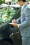 Mature man in suit inspecting car Stock Photo - Premium Royalty-Freenull, Code: 695-05766448