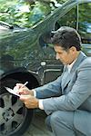 Mature man in suit inspecting car Stock Photo - Premium Royalty-Freenull, Code: 695-05766451