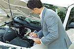 Mature man in suit inspecting car Stock Photo - Premium Royalty-Freenull, Code: 695-05766454