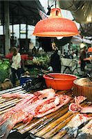 food stalls - Cut up fish in market stall Stock Photo - Premium Royalty-Freenull, Code: 695-05766675