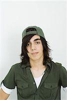 Teenage boy wearing cap, portrait Stock Photo - Premium Royalty-Freenull, Code: 695-05767331