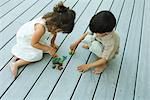 Boy and girl playing on deck Stock Photo - Premium Royalty-Free, Artist: Cusp and Flirt, Code: 695-05768139