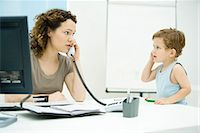 Woman using phone, young son imitating her, looking at each other Stock Photo - Premium Royalty-Freenull, Code: 695-05769241