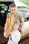 Father helping boy carry baguettes Stock Photo - Premium Royalty-Free, Artist: Masterfile, Code: 695-05769299