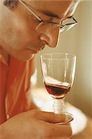 smelly - Man smelling red wine in wine glass Stock Photo - Premium Royalty-Freenull, Code: 695-05769313