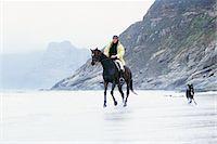 Man riding horse on beach Stock Photo - Premium Royalty-Freenull, Code: 695-05769428