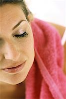 Woman with eyes closed, towel on shoulder Stock Photo - Premium Royalty-Freenull, Code: 695-05769639