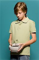 potted plant - Boy holding wilted potted plant Stock Photo - Premium Royalty-Freenull, Code: 695-05770683