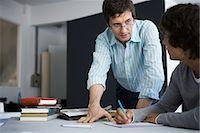 Teacher explaining assignment to student Stock Photo - Premium Royalty-Freenull, Code: 695-05770808