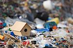 Birdhouse on ground surrounded by landfill trash Stock Photo - Premium Royalty-Free, Artist: Ikon Images, Code: 695-05770908