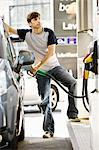 Man refueling vehicle at gas station Stock Photo - Premium Royalty-Free, Artist: Transtock, Code: 695-05771020