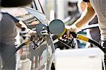 Refueling vehicle at gas station Stock Photo - Premium Royalty-Freenull, Code: 695-05771022