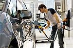 Man refueling vehicle at gas station Stock Photo - Premium Royalty-Free, Artist: Cultura RM, Code: 695-05771023