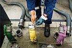 Preparing to fill gas station fuel storage tanks Stock Photo - Premium Royalty-Free, Artist: Ikon Images, Code: 695-05771049