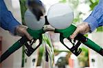 Refueling vehicle at gas station Stock Photo - Premium Royalty-Free, Artist: Ikon Images, Code: 695-05771073
