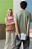 Teenage son preparing to present gift to mother Stock Photo - Premium Royalty-Freenull, Code: 695-05771309