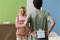 Teenage son preparing to present gift to mother Stock Photo - Premium Royalty-Freenull, Code: 695-05771310