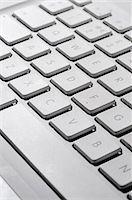 Laptop computer keyboard, close-up Stock Photo - Premium Royalty-Freenull, Code: 695-05771658