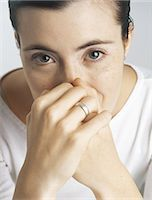 smelly - Woman covering mouth and nose with hands, portrait Stock Photo - Premium Royalty-Freenull, Code: 695-05772434
