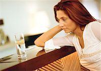 Woman sitting at bar Stock Photo - Premium Royalty-Freenull, Code: 695-05772587