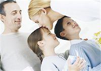 Family scene, mother kissing daughter on head Stock Photo - Premium Royalty-Freenull, Code: 695-05772639
