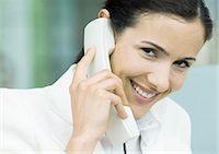 switchboard operator - Businesswoman using landline phone Stock Photo - Premium Royalty-Freenull, Code: 695-05772689