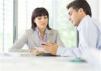 secretary desk - Man and woman having discussion in office Stock Photo - Premium Royalty-Freenull, Code: 695-05772799