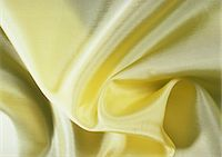 silky - Folds in yellow silk, close-up, full frame Stock Photo - Premium Royalty-Freenull, Code: 695-05772851