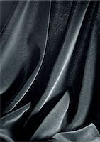 silky - Folds in shiny black fabric, close-up, full frame Stock Photo - Premium Royalty-Freenull, Code: 695-05772858