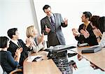 Business people in conference room, applauding standing businessman Stock Photo - Premium Royalty-Free, Artist: Aflo Relax, Code: 695-05772936