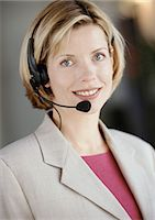 switchboard operator - Woman wearing headset, smiling at camera, portrait Stock Photo - Premium Royalty-Freenull, Code: 695-05772979