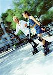 Mature woman and girl in-line skating, blurred Stock Photo - Premium Royalty-Free, Artist: Hiep Vu, Code: 695-05773387
