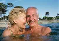 Mature couple standing in water at the beach, close-up Stock Photo - Premium Royalty-Freenull, Code: 695-05773433