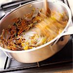 Close-up of food being stirred in pan on stove Stock Photo - Premium Royalty-Freenull, Code: 695-05773480