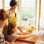 Woman and children cooking Stock Photo - Premium Royalty-Freenull, Code: 695-05773779
