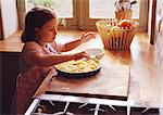 Child preparing pie Stock Photo - Premium Royalty-Freenull, Code: 695-05773791