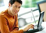 Man using laptop computer, portrait Stock Photo - Premium Royalty-Freenull, Code: 695-05773827