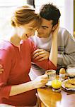 Pregnant woman and man having breakfast, smiling Stock Photo - Premium Royalty-Freenull, Code: 695-05773851