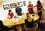 People in conference room, woman pointing finger at colleague Stock Photo - Premium Royalty-Free, Artist: AWL Images, Code: 695-05773867