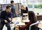 People talking in office Stock Photo - Premium Royalty-Freenull, Code: 695-05773899