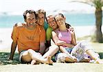 Family portrait at the beach, front view. Stock Photo - Premium Royalty-Free, Artist: Transtock, Code: 695-05773941