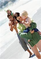 Man and woman holding young children at the beach. Stock Photo - Premium Royalty-Freenull, Code: 695-05773960