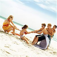 Group of people playing tug of war at the beach Stock Photo - Premium Royalty-Freenull, Code: 695-05774072