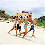 Teenagers and children in swimsuits holding surfboard and kite Stock Photo - Premium Royalty-Free, Artist: F1Online, Code: 695-05774076