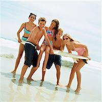Teenagers on beach holding surfboard Stock Photo - Premium Royalty-Freenull, Code: 695-05774077