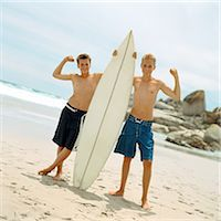 Two boys on beach holding surfboard Stock Photo - Premium Royalty-Freenull, Code: 695-05774078