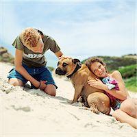 Children with dog on the beach Stock Photo - Premium Royalty-Freenull, Code: 695-05774083